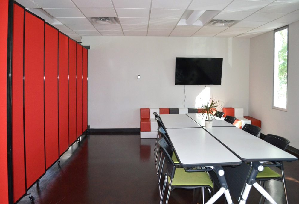 A wall mounted Room Divider breaks up this co working space when needed for  a meetingsOffice Partitions and Dividers   Portable Partitions New Zealand. Office Wall Dividers Nz. Home Design Ideas